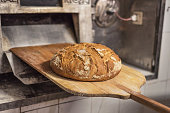 Baking bread in shovel at the bakery
