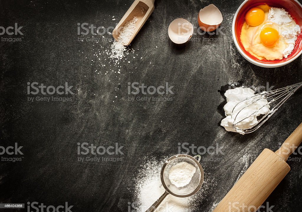 Baking cake ingredients on black from above stock photo