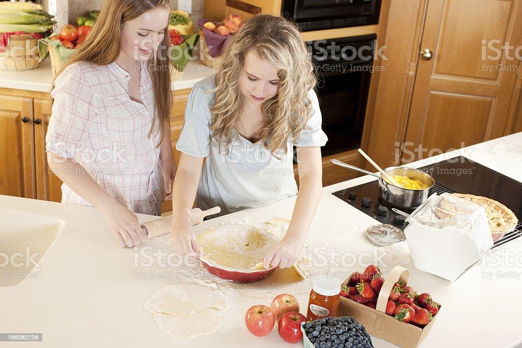 Baking: Caucasian Teenage Girl Friends Making Homemade Fruit Dessert royalty-free stock photo