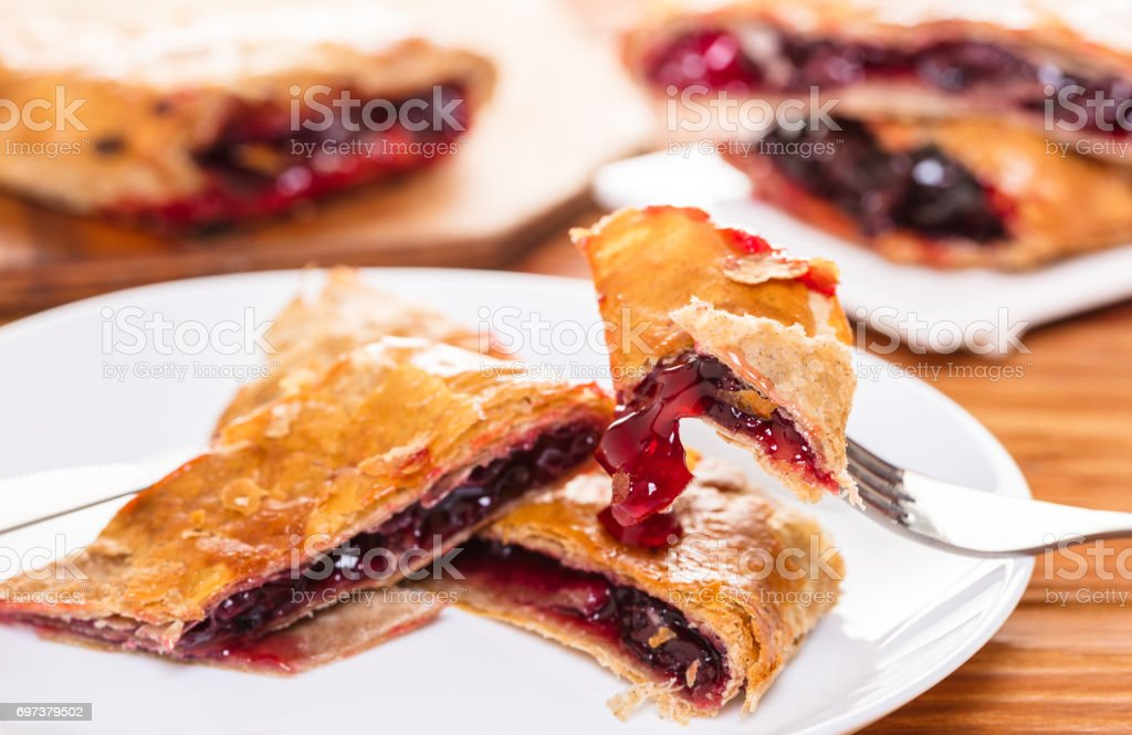 Baking, cherry strudel in a plate stock photo