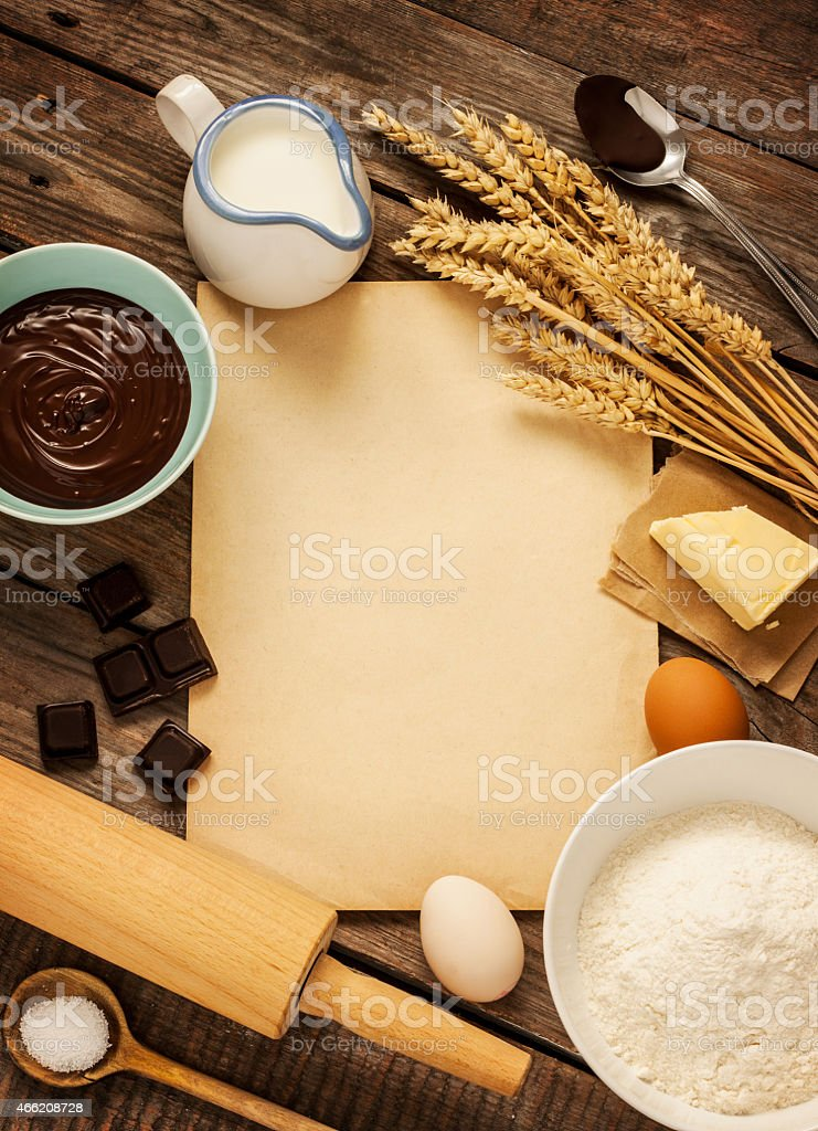 Baking chocolate cake. Ingredients and blank paper - background. stock photo