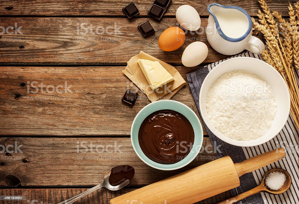 Baking chocolate cake - recipe ingredients on vintage wood stock photo