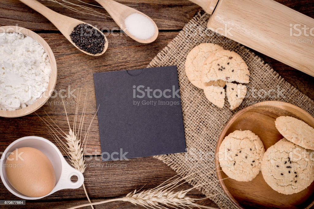 baking cookie ingredients and cooking utensils around. stock photo