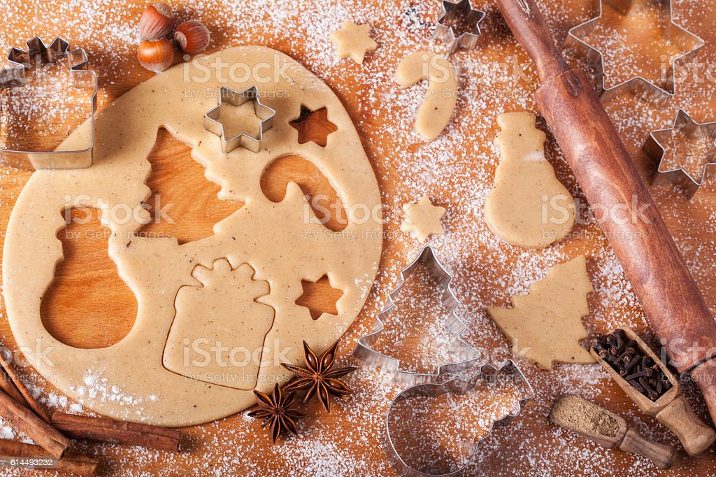 Baking Cookies with Gingerbread Christmas Cookie Cutters in Dough stock photo