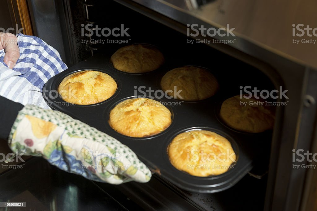 Baking cupcakes in a home oven stock photo