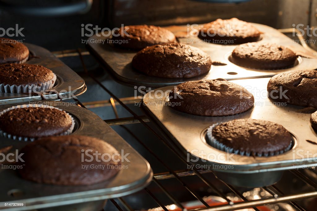 Baking Cupcakes in an Oven Pan stock photo