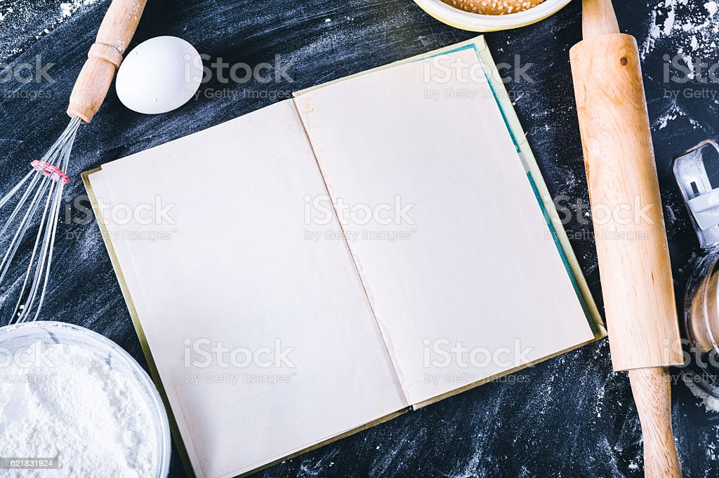 Baking dark background with blank cook book stock photo