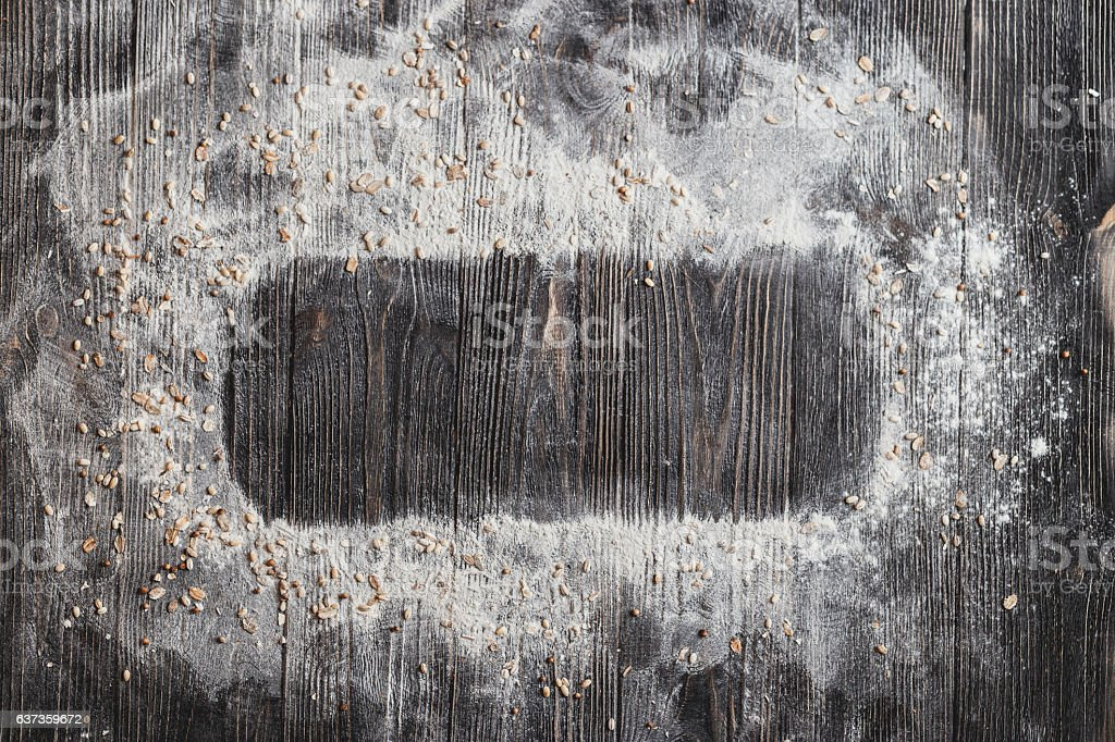 Baking desk with flour, top view, space for text. stock photo
