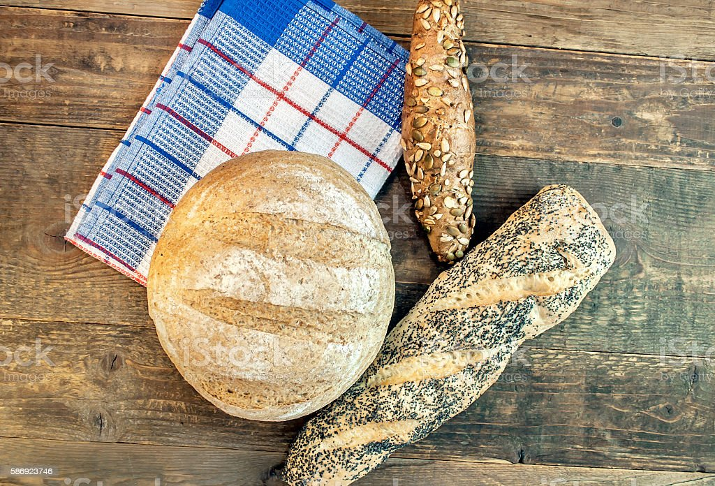 Baking dietary various bread isolated on wooden table on dishcloth stock photo