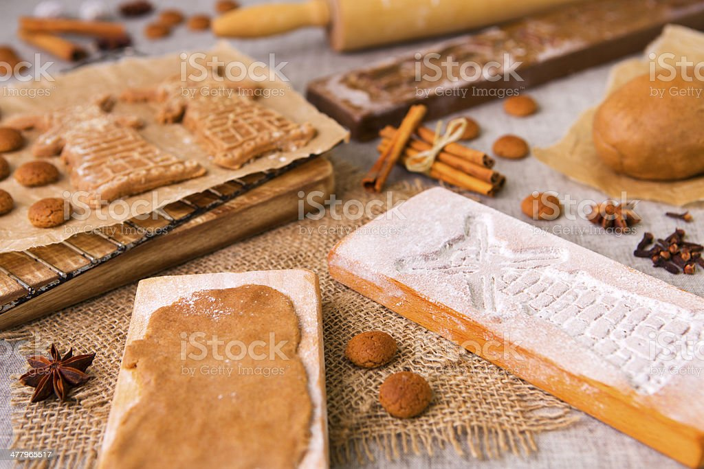 Baking Dutch speculaas cookies with authentic wooden cookie cutters stock photo