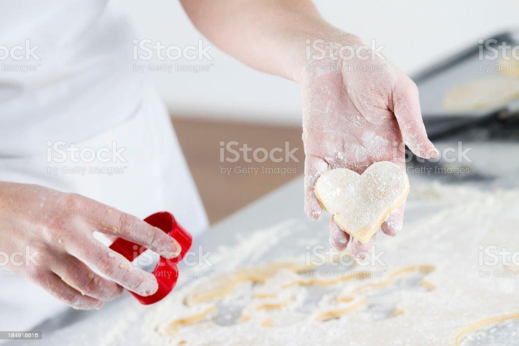 Baking Heart Shaped Cookies royalty-free stock photo