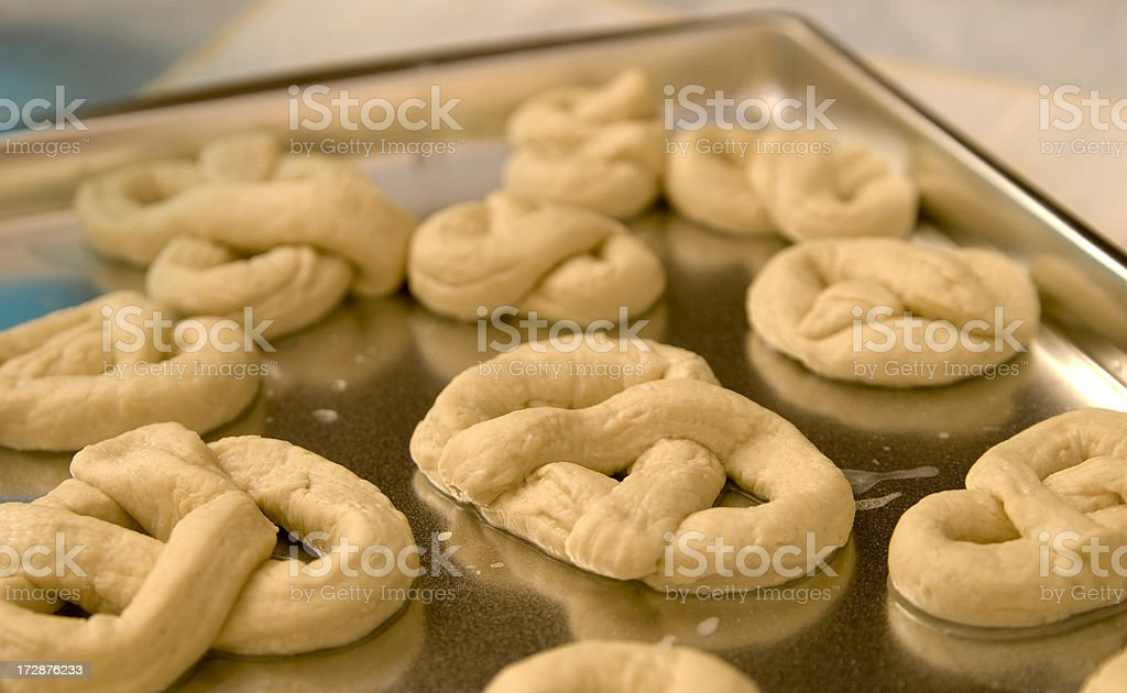 Baking Homemade Pretzels on Cookie Sheet royalty-free stock photo