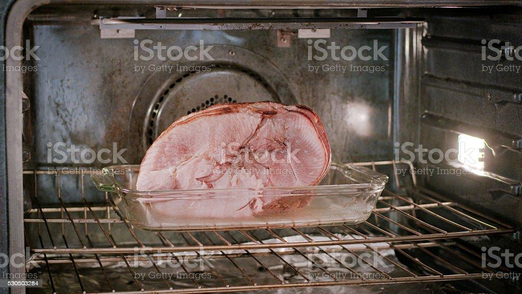 Baking Honey Glazed Ham in the Oven stock photo