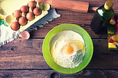 Baking in old rustic kitchen. Eggs and flour