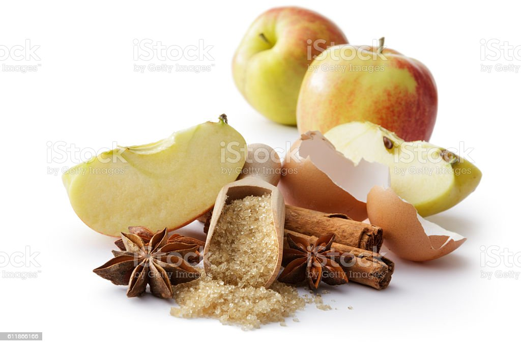 Baking Ingredients: Cinnamon, Anise, Sugar, Egg and Apple stock photo