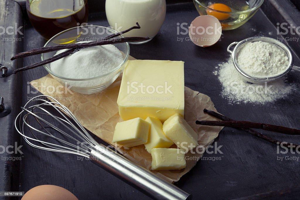 Baking ingredients eggs, flour, sugar, butter, vanilla, cream stock photo