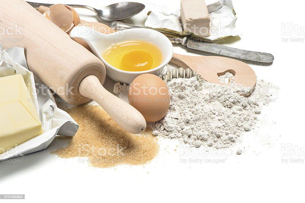 baking ingredients eggs, flour, sugar, butter, yeast stock photo