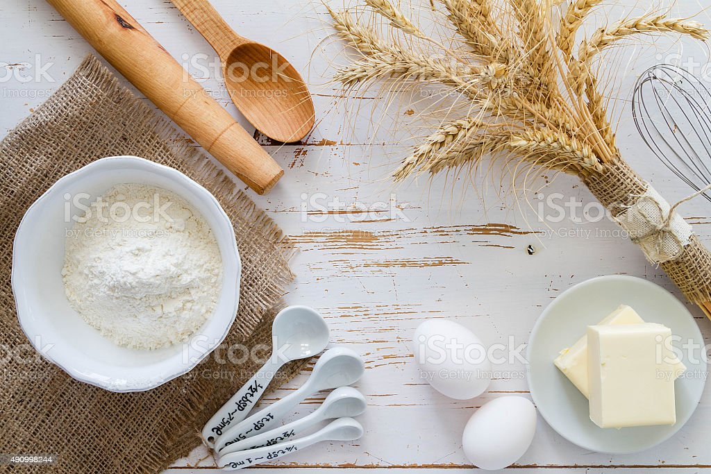 Baking ingredients - milk flour butter eggs stock photo