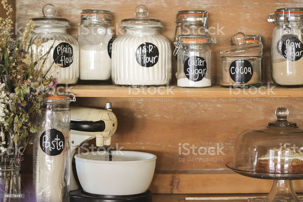 Baking Ingredients on antique hutch stock photo