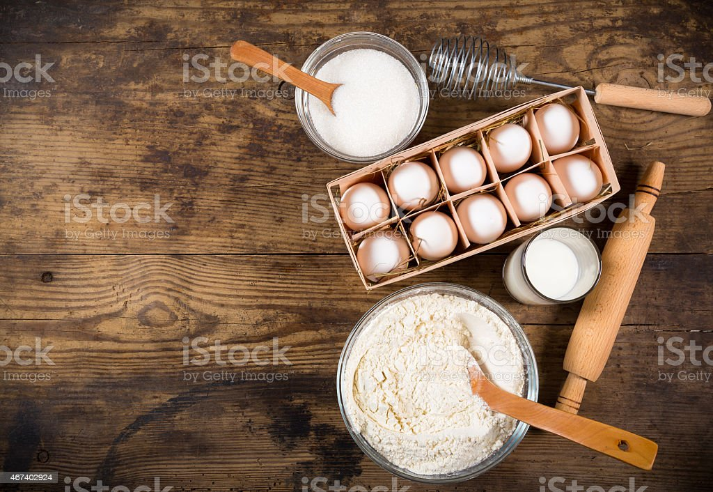 baking ingredients on brown table stock photo