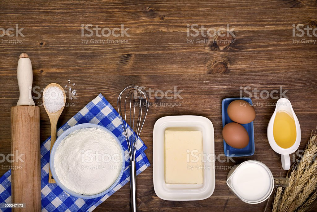 Baking ingredients on wooden background with text space stock photo