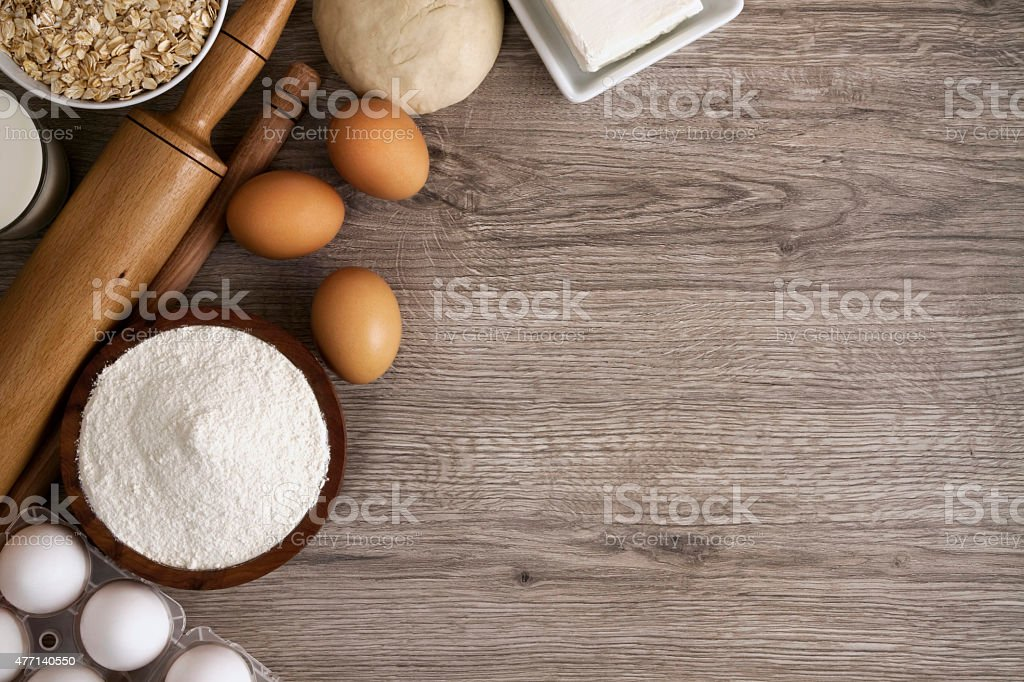Baking Ingredients on Wooden Table stock photo