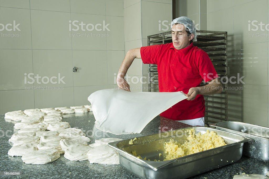 Baking man forming dough royalty-free stock photo