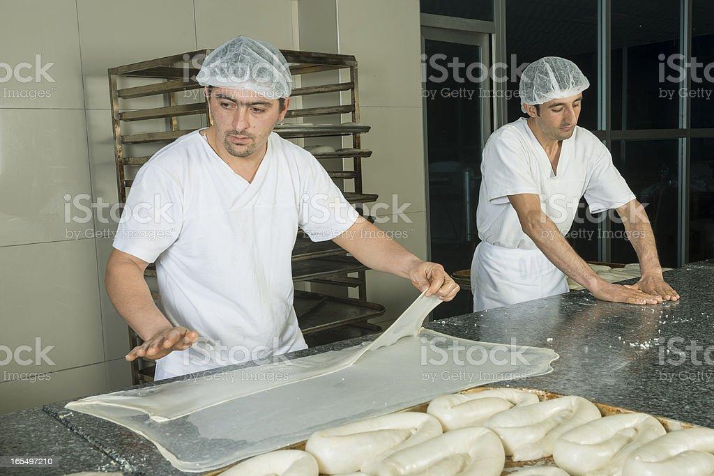 Baking men forming dough royalty-free stock photo