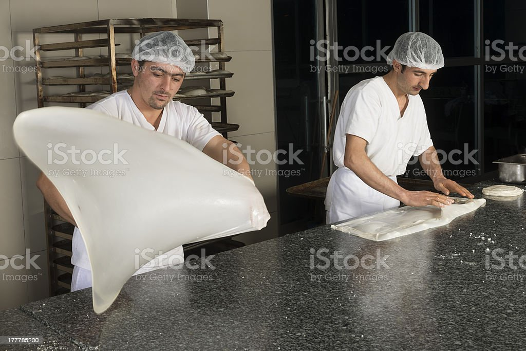 Baking men forming dough stock photo