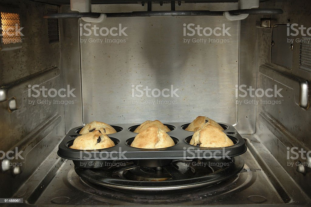 Baking muffins in oven royalty-free stock photo