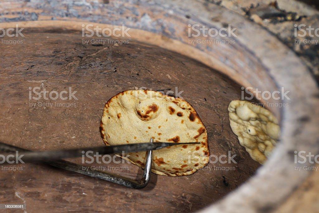 baking naan stock photo
