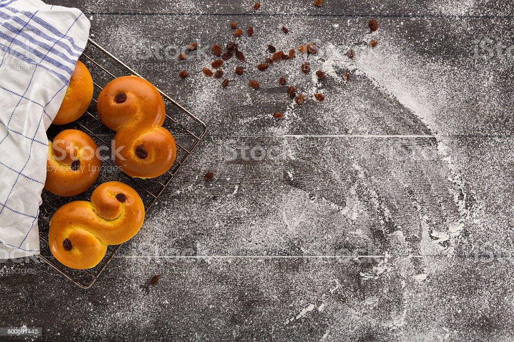 Baking of swedish saffron buns. stock photo
