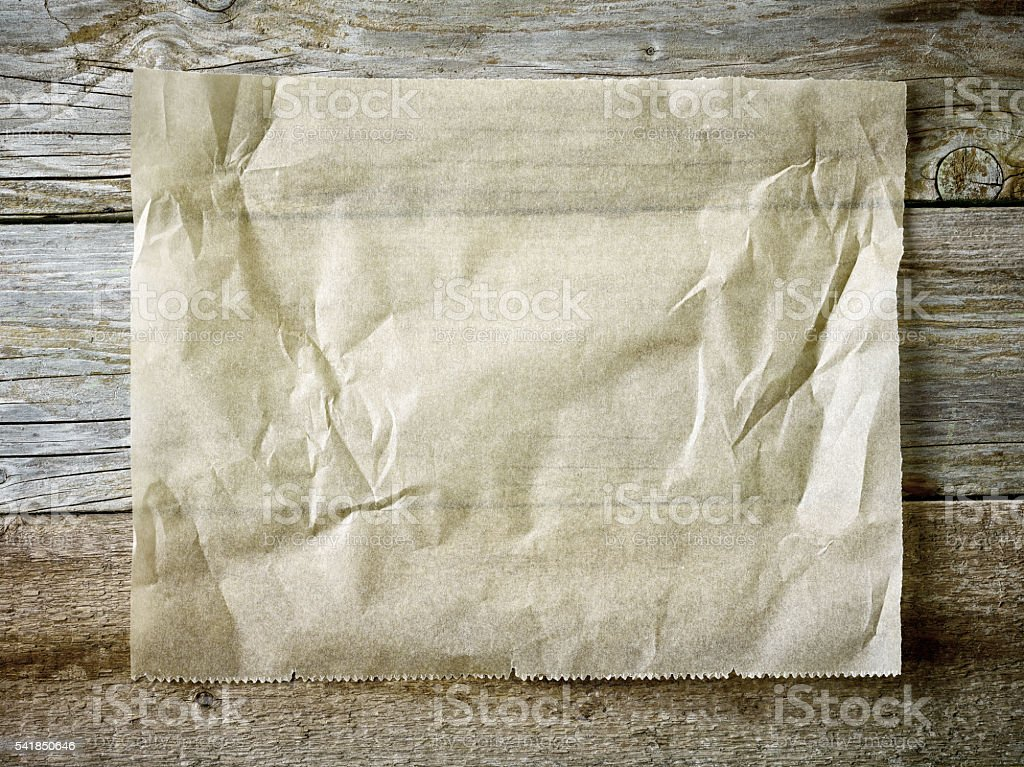 baking paper sheet on wooden table stock photo