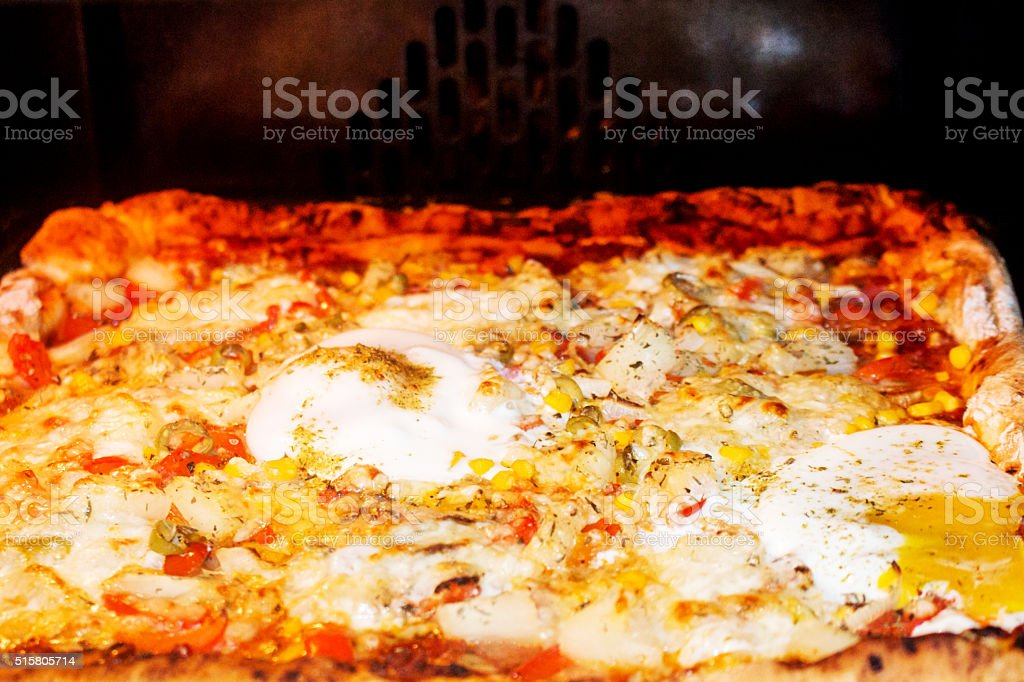 baking pizza in oven stock photo