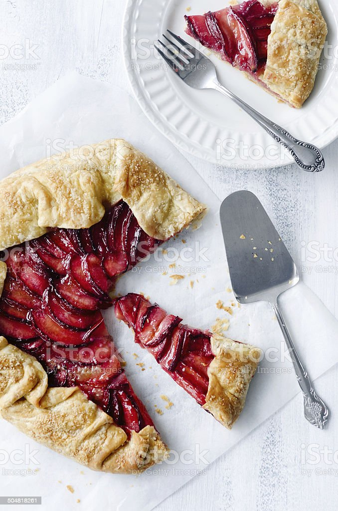 Baking plum galette, a rustic french dessert pie stock photo