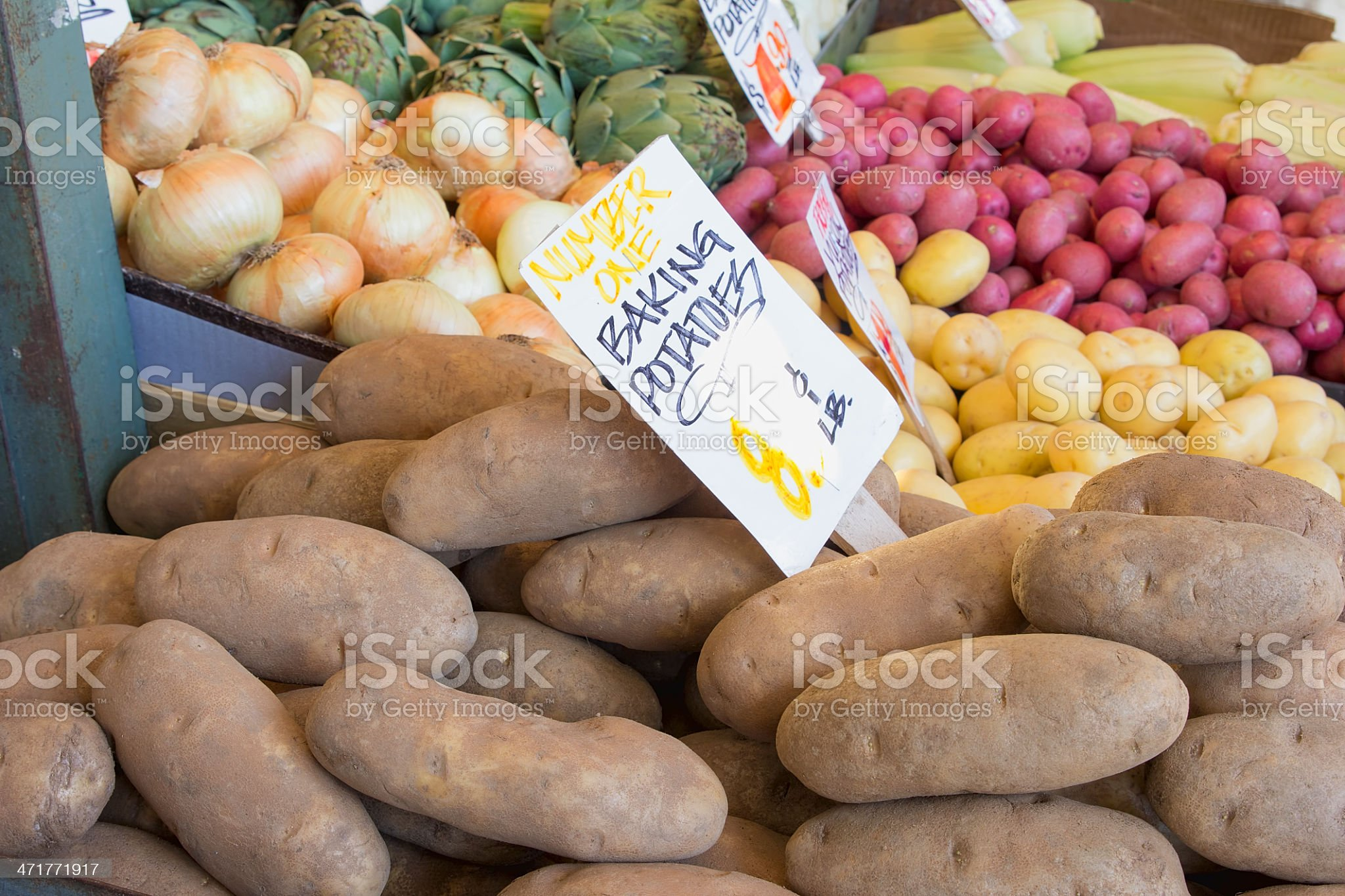 Baking Potatoes and Vegetables Stall Display royalty-free stock photo