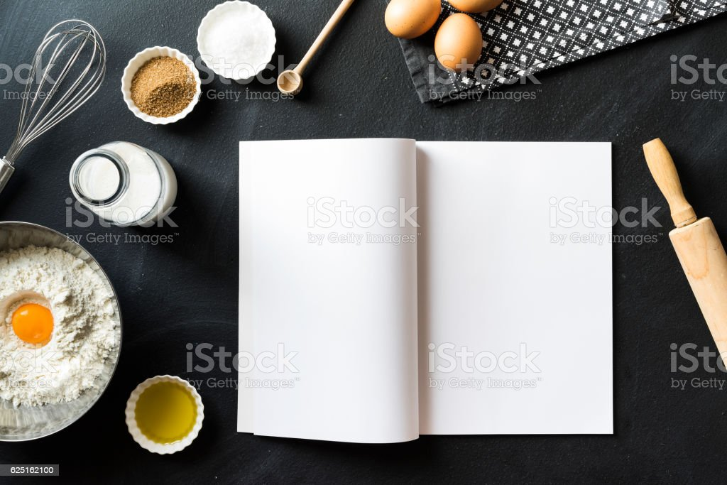 Baking recipe, open magazine with white blank pages on blackboard stock photo