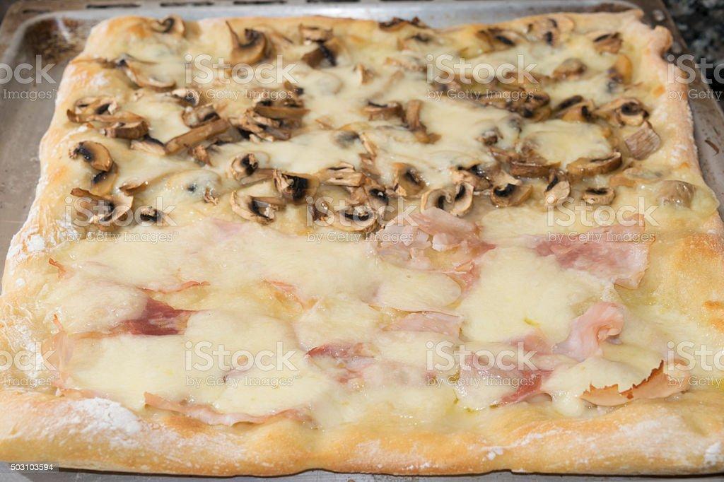 baking sheet of pizzaat two taste stock photo