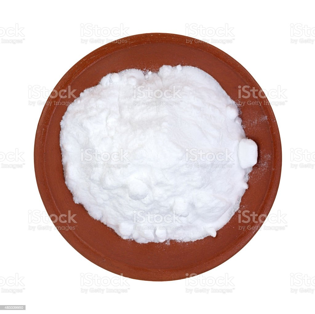 Baking soda in red clay bowl stock photo