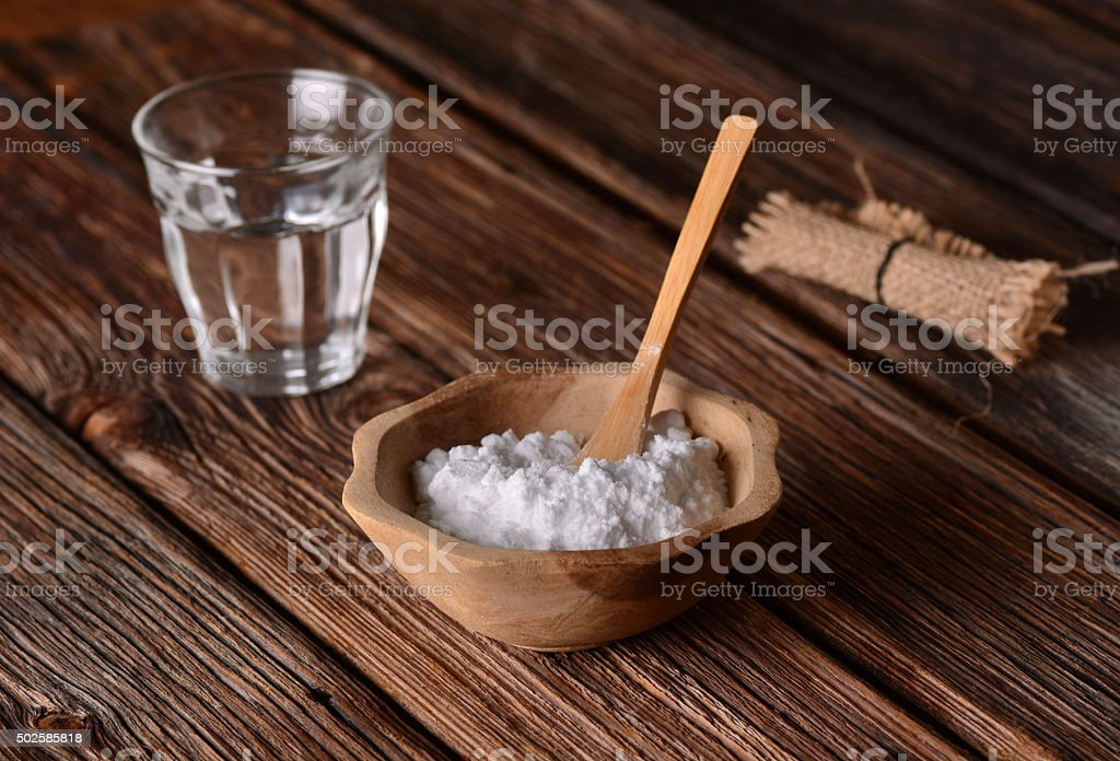 baking soda into the bowl stock photo