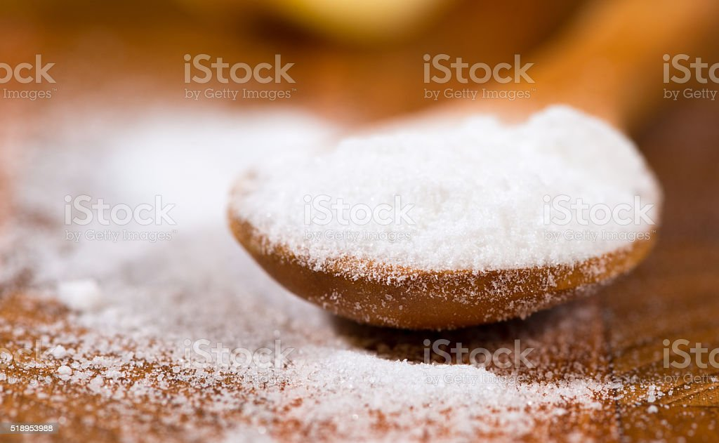 baking soda (Sodium bicarbonate) on a wooden spoon stock photo
