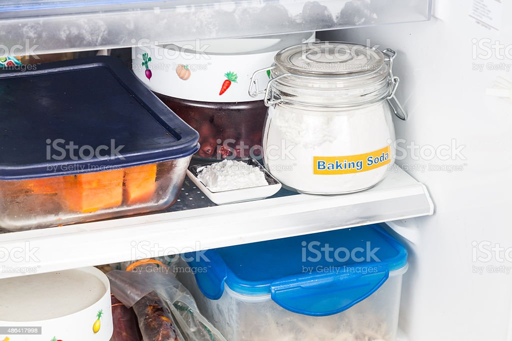 Baking soda placed in refrigerator to deodorize bad odor. stock photo