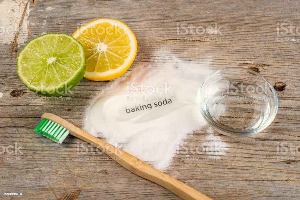Baking soda, water, lemon, sponge and toothbrush stock photo