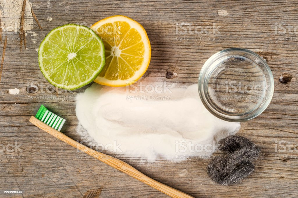 Baking soda, water, lemon, sponge, toothbrush and steel wool stock photo