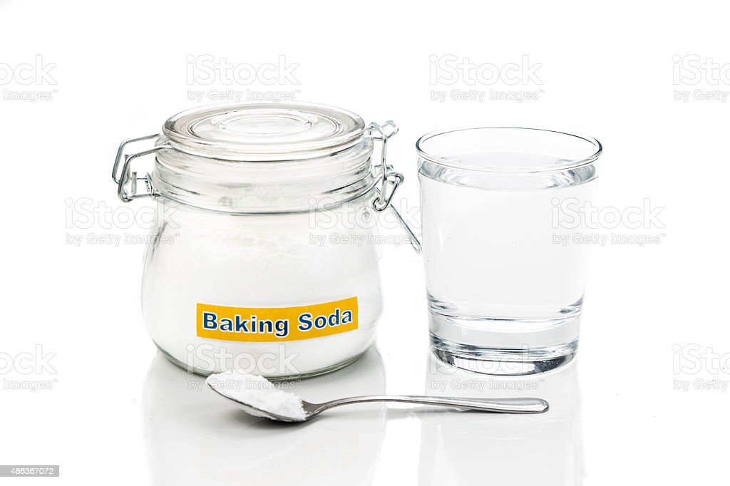 Baking soda with glass of water for multiple holistic usages stock photo