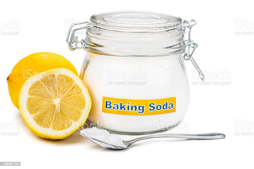Baking soda with lemon juice for multiple holistic usages stock photo