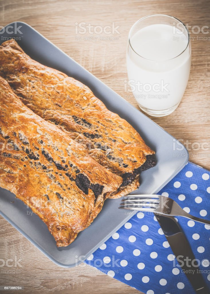 Baking, strudel with poppy seeds and milk stock photo