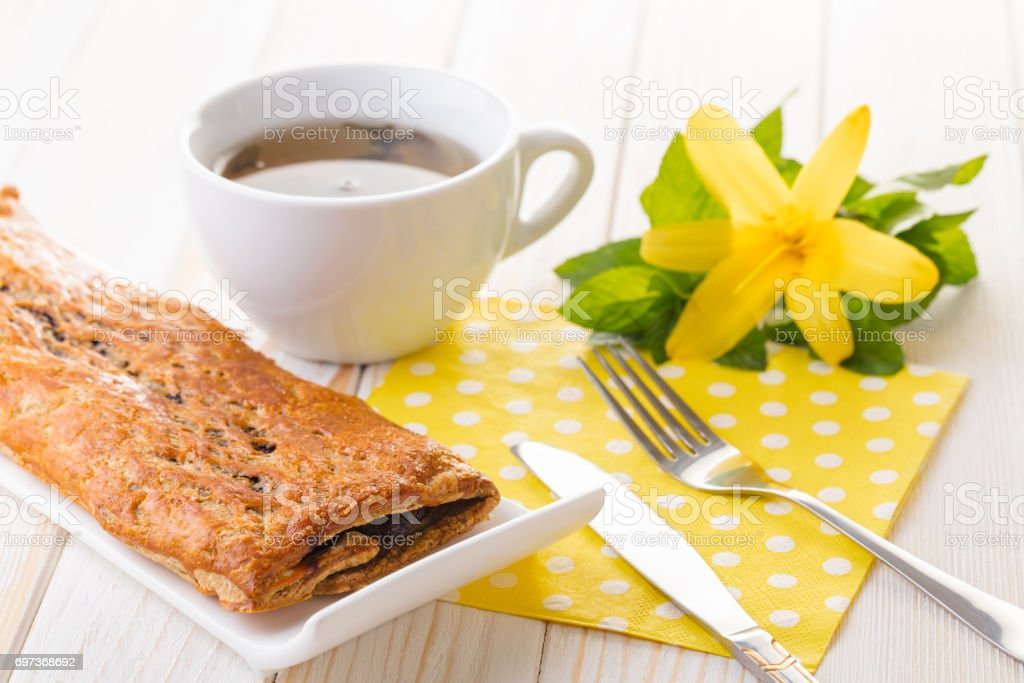 Baking strudel with poppy seeds and tea stock photo