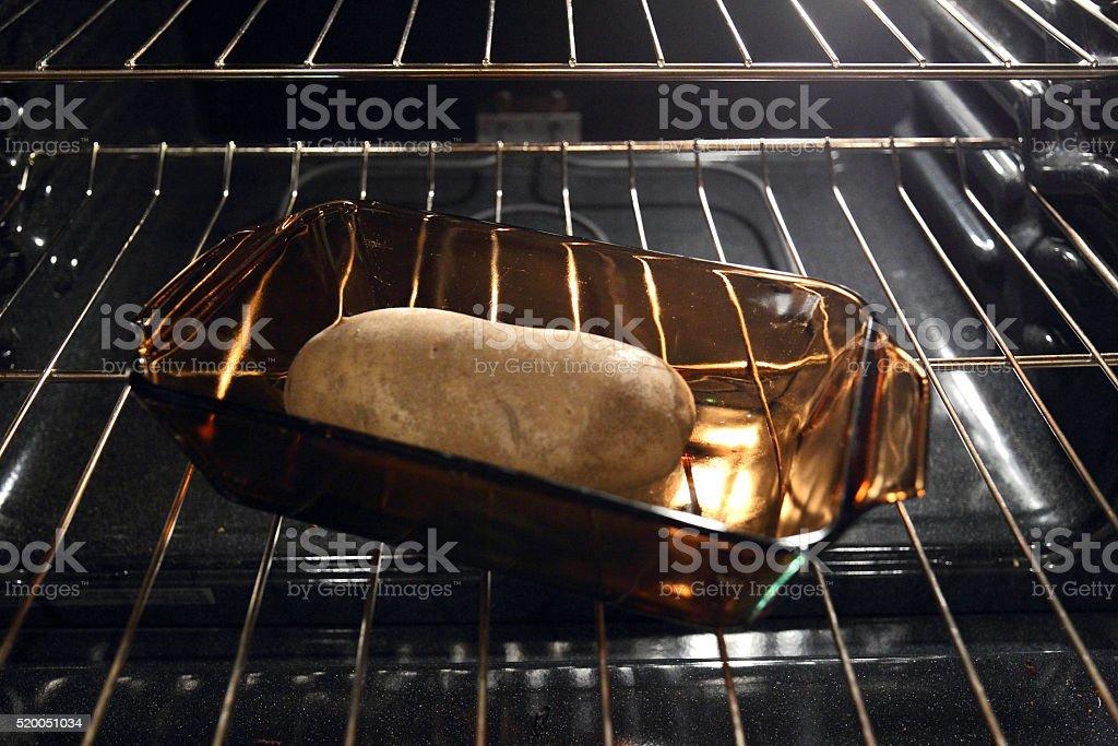 Baking the potato stock photo