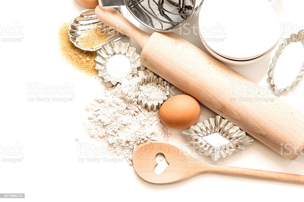 baking tools and ingredients. flour, eggs, sugar, rolling pin stock photo